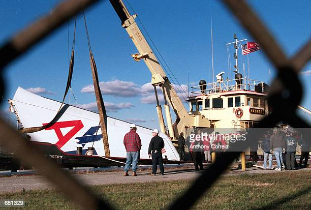 The wrecked tail from American Airline flight 587 is lifted out of Jamaica Bay November 12, 2001 in Far Rockaway, New York City. The plane with 255...