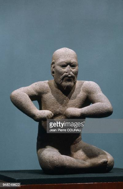 The WRESTLER a 66cm high OLMEC sculpture dating from the Preclassic period and preserved at the National Museum of Anthropology in Mexico City Mexico...