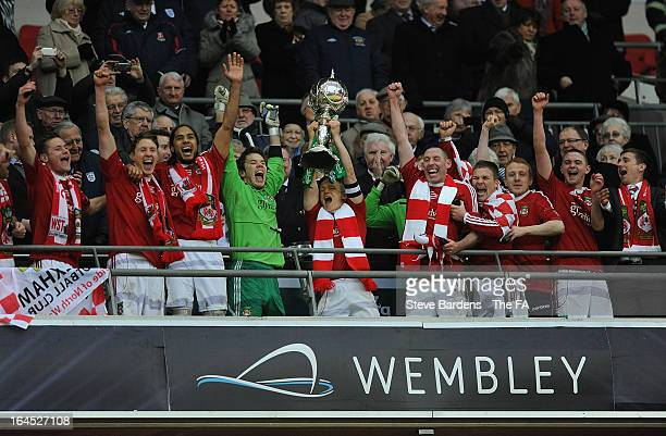 The Wrexham captain Dean Keates lifts the FA Trophy as his team mates celebrate their victory in the FA Trophy Final between Wrexham and Grimsby Town...