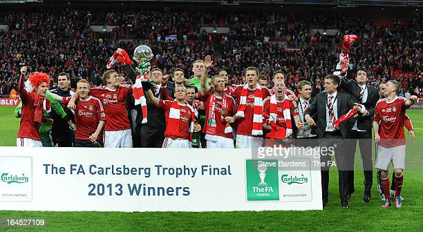 The Wrexham players celebrate their victory with the FA Trophy after winning the FA Trophy Final between Wrexham and Grimsby Town at Wembley Stadium...