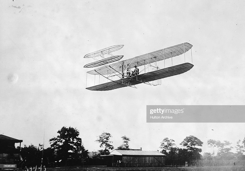 The Wright 1907 model bi-plane flying at Hunaudieres racecourse, near Le Mans, France.