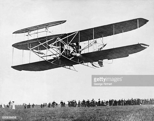 The Wright Brothers give a demonstration of their Wright Model A airplane