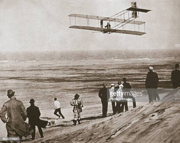 The Wright Brothers testing an early plane at Kitty Hawk North Carolina USA c1903 Wilbur and Orville Wright testing a plane with an engine instead of...