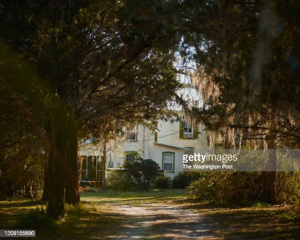 The Wright House, where John Wright helped black residents of Rosewood flee the massacre, is seen from the road in Rosewood, Florida on Wednesday,...