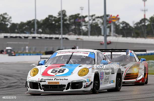 The Wright Motorsports Porsche 911 America driven by Madison Snow, Jan Heylen, Patrick Dempsey and Phillipp Eng on track during practice for The...