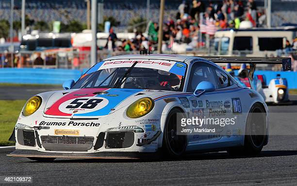 The Wright Motorsports Porsche 911 America driven by Madison Snow, Jan Heylen, Patrick Dempsey and Phillipp Eng races during the Rolex 24 at Daytona...