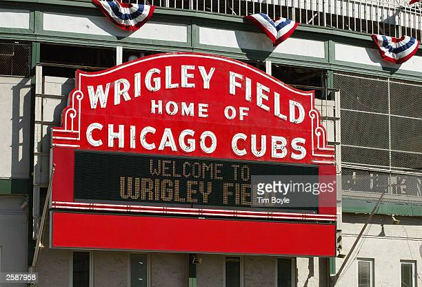 "The ""Wrigley Field Home Of The Chicago Cubs"" marquee is visible October 13, 2003 Chicago, Illinois. The Cubs are one win away from playing in their..."
