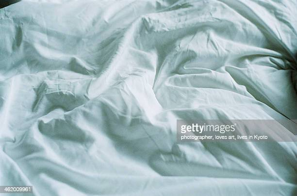The wrinkled bed sheet