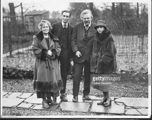 The writer GK Chesterton with his wife and another couple in the garden of their home in Beaconsfield Buckinghamshire 1926