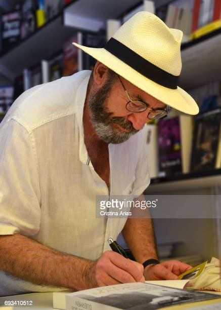 The writer Juan Madrid signs a book during the Book Fair 2017 at El Retiro Park on June 3 2017 in Madrid Spain