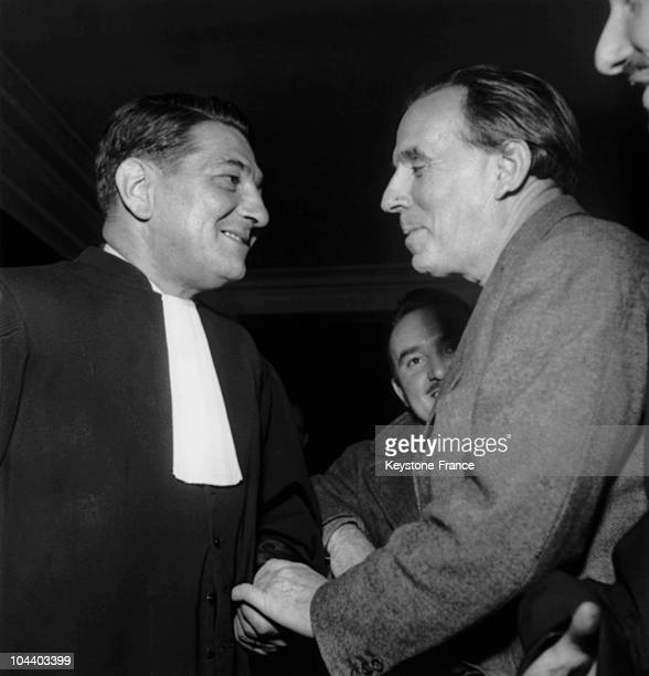 The writer LouisFerdinand CELINE talking with his lawyer Mr TIXIERVIGNANCOURT in the corridors of the Palais de Justice The writer reckoned he was...