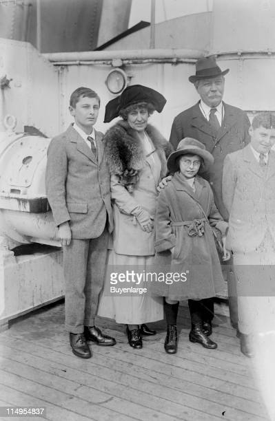 The writer Sir Arthur Conan Doyle stands with his wife Lady Jean Conan Doyle and their family Dennis Lena and Adrian on an unidentified ocean liner...
