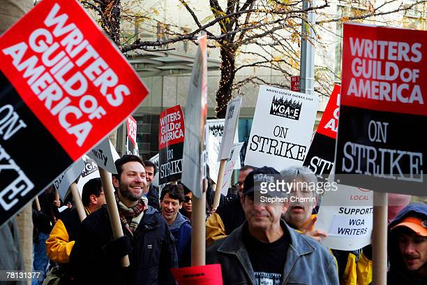 The Writers Guild of America strike continues into its fourth week as union members picket in front of the Time Warner building November 28 2007 in...