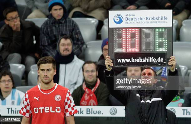 The writing '40 Jahre Deutsche Krebshilfe' is seen on the substitution panel during the Second Bundesliga match between 1860 Muenchen and Fortuna...