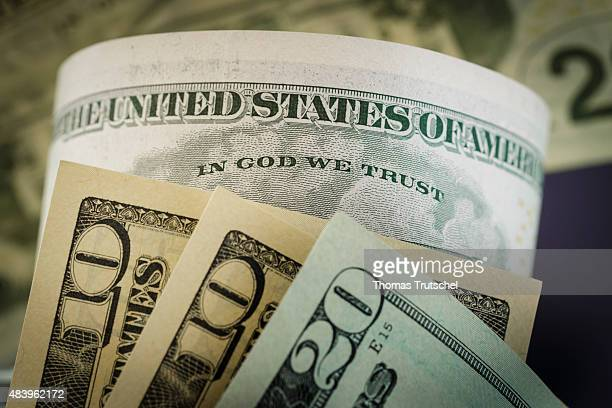 The writing ' In God we trust ' is seen on a dollar bill on August 14 in Berlin Germany