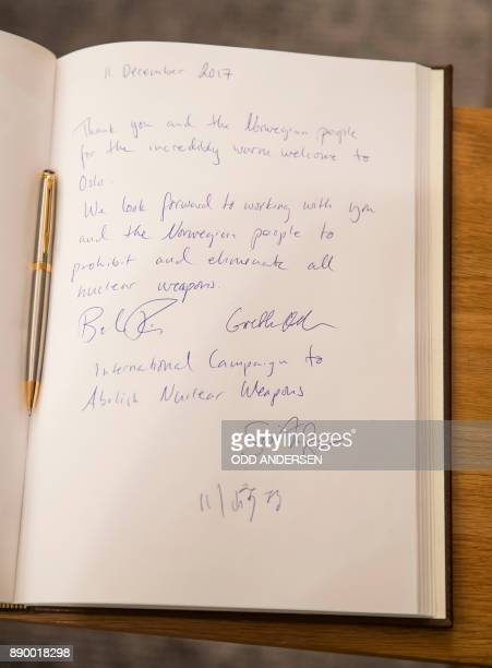 The writing of Nobel Peace Prize laureate Beatrice Fihn leader of ICAN is seen in the guest book of Norwegian prime minister in Oslo on December 11...