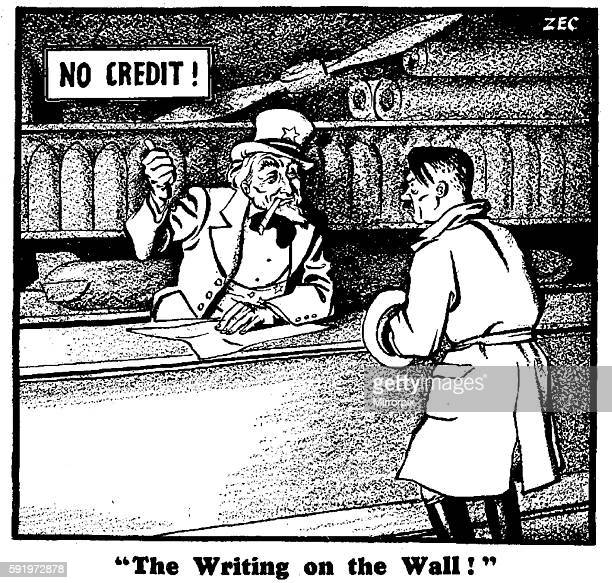The Writing on the Wall 4th November 1939 Uncle Sam points to a No Credit sign as Adolf Hitler approaches the counter