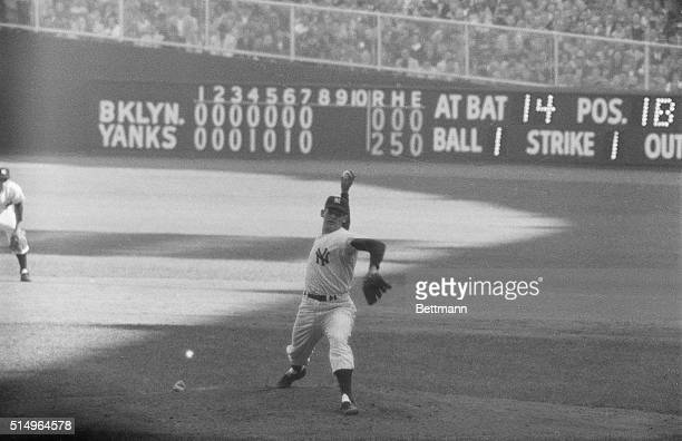 The Writing on the Wall New York Yankee hurler Don Larsen studies the scoreboard at Yankee Stadium in the top of the 8th inning as he neared the feat...