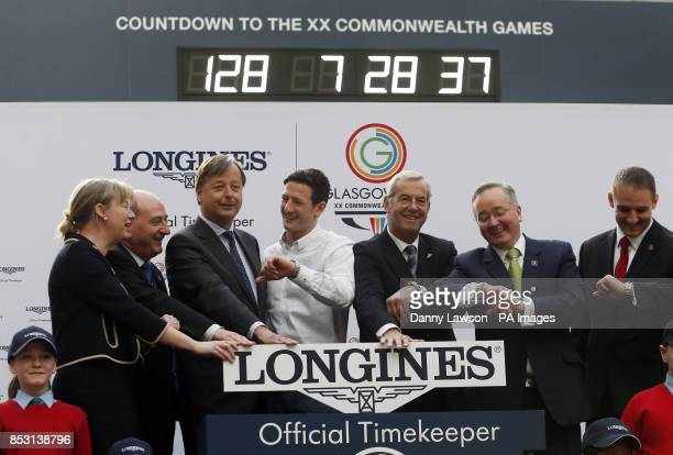 The wrong time is shown on the Official Glasgow 2014 Countdown Clock in Glasgow Central Station Scotland as it is switched on by Minister for Sport...