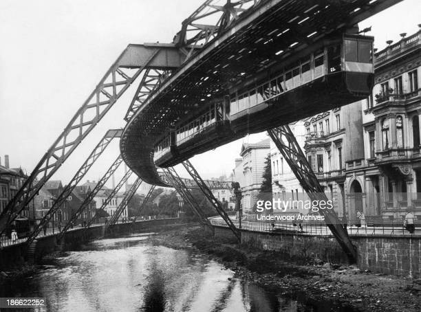 The Wuppertal Suspension Railway which opened in 1901 Germany late 1900s or early 1910s The electric elevated monorail line is the oldest in the world