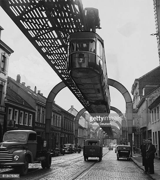 The Wuppertalk Schwebebahn a twocar suspended monorail train on the Suppertal monorail system