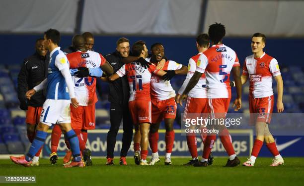 The Wycombe Wanderers team celebrate after an own goal from Kristian Pedersen of Birmingham City during the Sky Bet Championship match between...