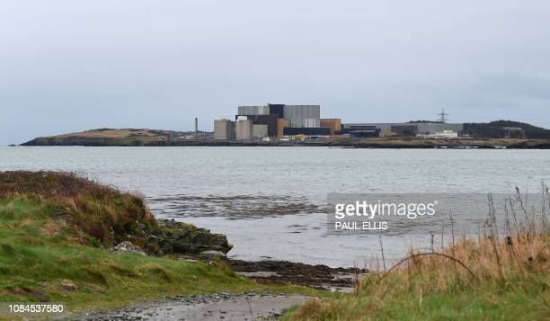 The Wylfa Newydd nuclear power station is pictured from across Cemlyn Bay on Anglesey northwest Wales on January 18 2019 Hitachi on Thursday froze...