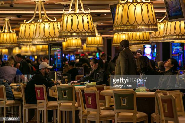 """The Wynn Hotel & Casino card game floor is viewed on December 7, 2015 in Las Vegas, Nevada. Tourism in America's """"Sin City"""" has, within the past two..."""