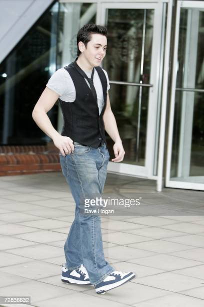 The X Factor finalist Ray Quinn demonstrates his wheeled trainers at a portrait shoot in Wapping on December 13 2006 in London England