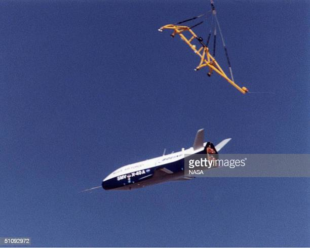 The X40A Is Released From Its Harness Suspended From A Helicopter 15000 Feet Above Nasa's Dryden Flight Research Center At Edwards Air Force Base In...