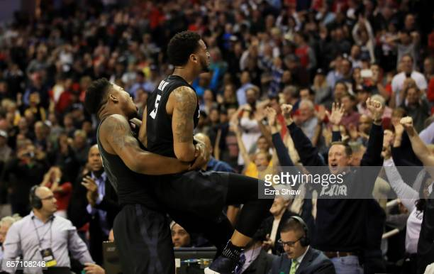 The Xavier Musketeers celebrate their 73 to 71 win over the Arizona Wildcats during the 2017 NCAA Men's Basketball Tournament West Regional at SAP...