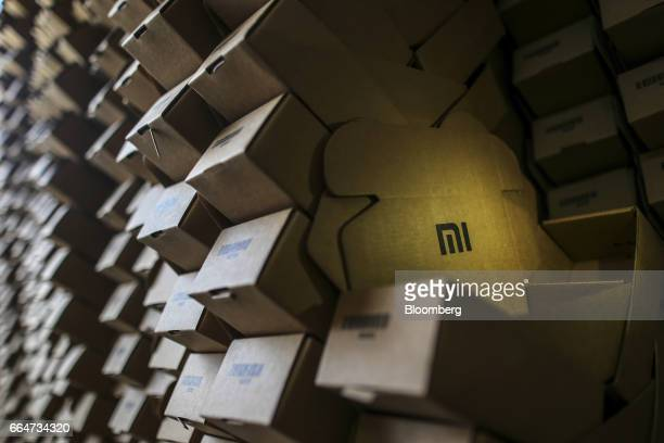 The Xiaomi Corp logo is seen on a box at a logistics center run servicing the company located inside a Blue Dart Express Ltd and DHL Express India...