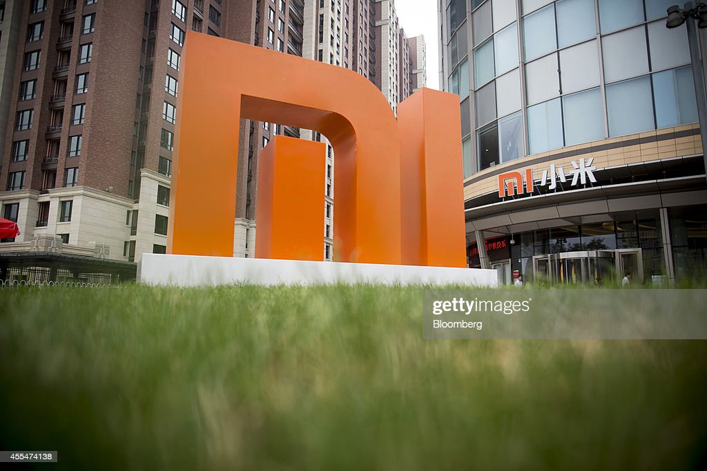 The Xiaomi Corp. logo stands outside the company's headquarters in Beijing, China, on Friday, Sept. 12, 2014. Xiaomi Chief Executive Officer Lei Jun plans to boost global smartphone sales fivefold to 100 million units next year. Photographer: Brent Lewin/Bloomberg via Getty Images