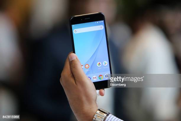 The Xiaomi Corp Mi A1 dual camera device is held for a photograph during the smartphone's launch in New Delhi India on Tuesday Sept 5 2017 Google is...