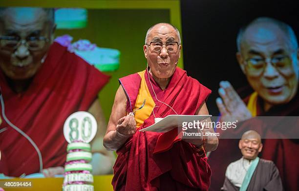 The XIV Dalai Lama eats birthday cake during his 80th birthday celebrations at the 'Jahrhunderthalle' on July 13 2015 in Frankfurt Germany
