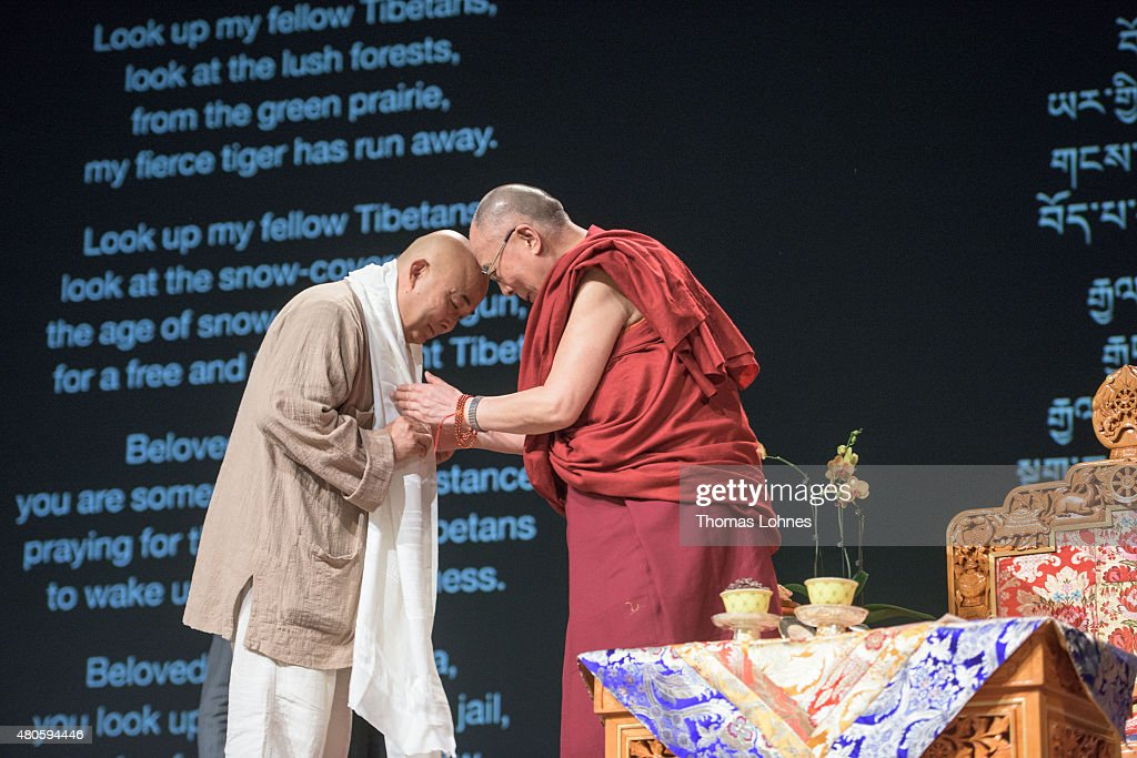The XIV Dalai Lama greets the Chinese writer Liao Yiwu during his 80th birthday celebrations at the 'Jahrhunderthalle' on July 13, 2015 in Frankfurt, Germany.