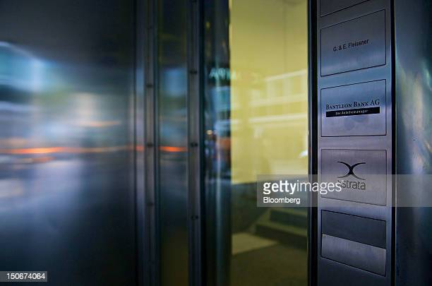 The Xstrata Plc logo sits on a plaque outside the shared building that houses the company's headquarters in Zug, Switzerland, on Friday, Aug. 24,...