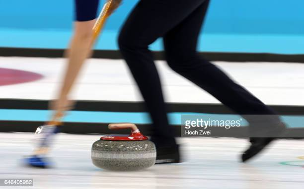The XXII Winter Olympic Games 2014 in Sotchi Olympics Olympische Winterspiele Sotschi 2014 Curling competition stone stones Stein Steine rock rocks...