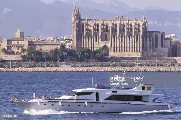The yacht Fortuna in the Bay of Mallorca The yacht of the Royal familiy with the Cathedral and the city behind