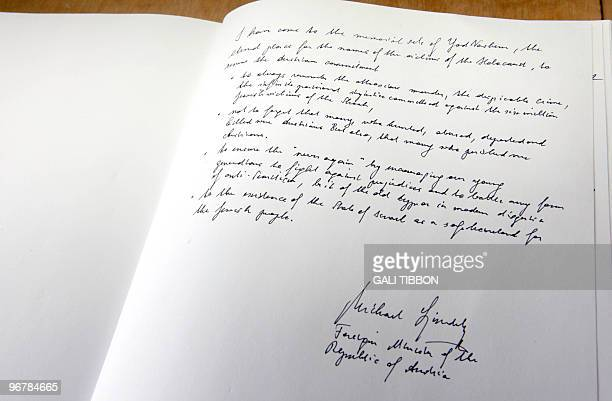 The Yad Vashem guestbook is signed by Austrian Foreign Minister Michael Spindelegger during his visit to the Yad Vashem Holocaust memorial in...