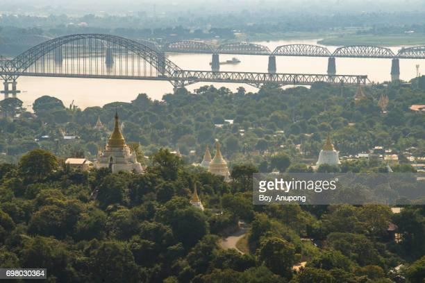 The Yadanabon Bridge (Irrawaddy Bridge) on the Irrawaddy river view from top of Sagaing hills, Myanmar.