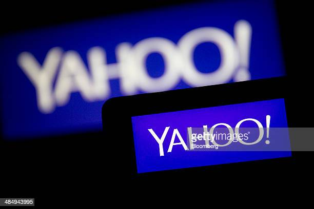 The Yahoo Inc logo is displayed on an Apple Inc iPhone 5s and laptop computer in this arranged photograph in Washington DC US on Tuesday April 15...