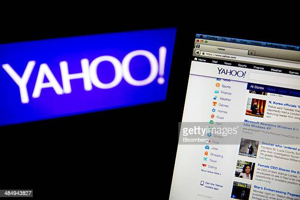 The Yahoo Inc website and logo are displayed on laptop computers in this arranged photograph in Washington DC US on Tuesday April 15 2014 Yahoo Inc...