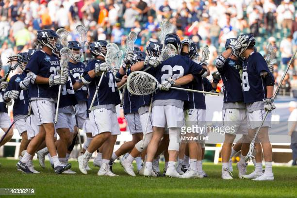 The Yale Bulldogs celebrate after defeating the Penn State Nittany Lions in the 2019 NCAA Division I Men's Lacrosse Championship Semifinals at...