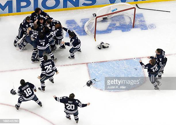 The Yale Bulldogs celebrate after defeating the Quinnipiac Bobcats in the Men's Ice Hockey National Championship game at Consol Energy Center on...