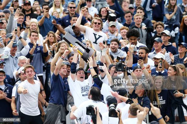 The Yale Bulldogs celebrate with their fans after defeating the Duke Blue Devils 1311 in the 2018 NCAA Division I Men's Lacrosse Championship game at...
