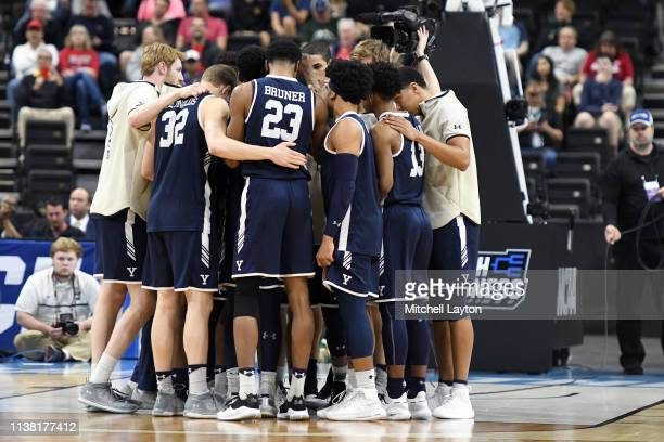The Yale Bulldogs huddle before the First Round of the NCAA Basketball Tournament against the Yale Bulldogs at the VyStar Veterans Memorial Arena on...