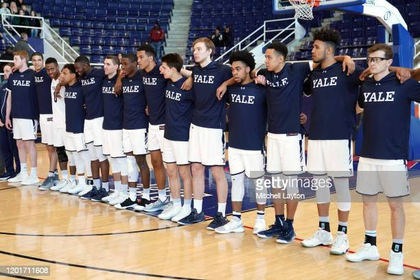 The Yale Bulldogs line up for the National Anthem before a college basketball game against the against the Howard Bison at Burr Gymnasium on January...