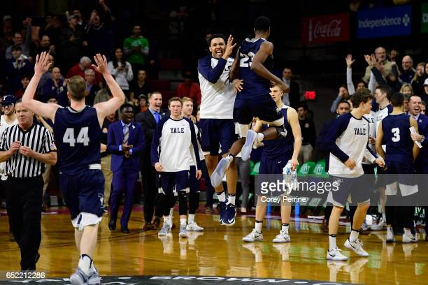 The Yale Bulldogs react to defeating the Harvard Crimson at The Palestra during an Ivy League tournament semifinal matchup on March 11 2017 in...