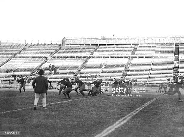 The Yale football team at practice New Haven Connecticut 1913 The quarterback is preparing to throw the ball